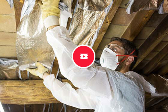 man surveying asbestos problems with a video icon on top